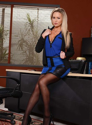Boss lady Abbey Brooks commands respect in mini skirt and high heels