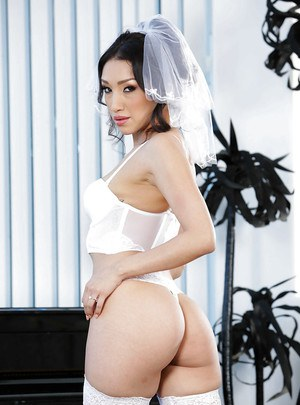 Asian MILF Vicki Chase strips off wedding dress for shaved cunt spread