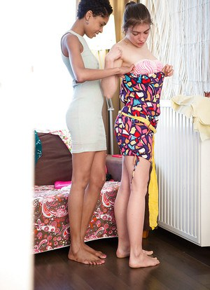 Horny amateur lesbian babes Flora and Luna slowly putting on their clothes