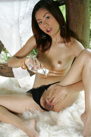 Sexy young babe from Thailand stripping naked in the great outdoors