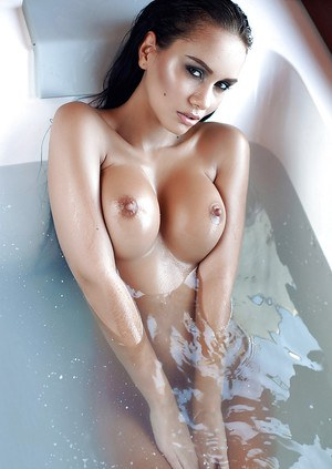 Busty model Vivien flaunting her huge breasts in the bathroom