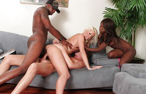 Hotties Courtney Young and Whitney William enjoy interracial anal sex