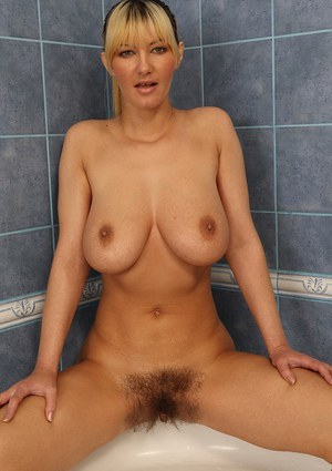Busty MILF Vanesaa Lovely flashing her hairy cunt in the shower