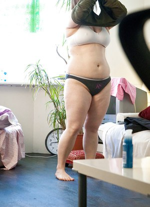 Fatty Kayla T pulls on underwear after modelling in the nude