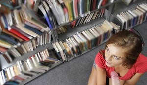 Innocent amateur teen Emma sucking a hard cock in a public library