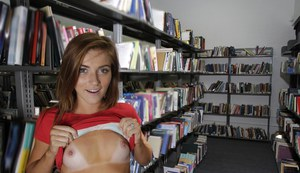 Big ass brunette babe Emma getting naked and flashing in a library