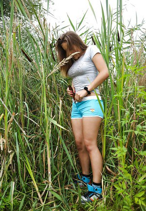 Young girl Adelle goes outdoors to masturbate hairy teen pussy