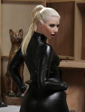 Hot blonde babe Anikka Albrite posing solo in kinky latex uniform