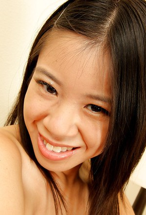 Shaved Asian amateur babe Asia Zo taking off her skirt and posing nude
