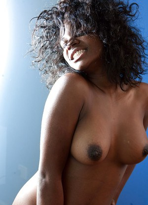 Ebony amateur Manuela removes denim skirt and panties for black cunt spread