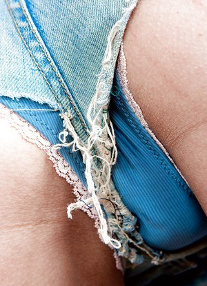 Mixed race lady Aline rids denim shorts and plays with all natural tits