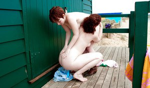 Redhead teens Maria S and Tricia L licking nipples and hairy cunts outdoors