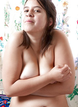 Amateur BBW Nikki S strips naked to bare fat tits and pussy