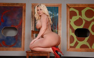 Big boobed blonde Julie Cash posing solo in pantyhose and high heels