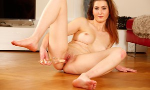 Amateur chick Dorothy Glade bends over and uses dildo on shaved vagina