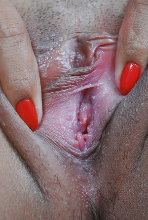 Petite Asian removes military uniform to finger shaved Oriental pussy
