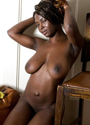 Ebony amateur Marika strips naked and flaunts large black breasts