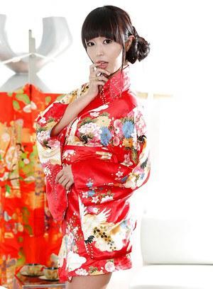 Japanese babe Marica Hase does a slow striptease out of Geisha uniform