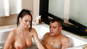 Busty pornstar Alektar Blue giving handjob and titjob in the bathtub