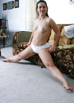 Hirsute amateur Lilou pulls down white panties for hairy cunt viewing