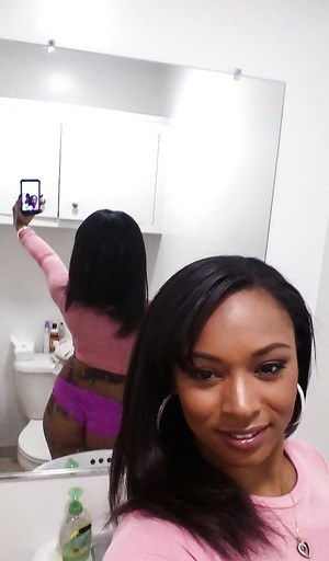 Curvy black chick Porsha Carrera taking selfies of her big black tits