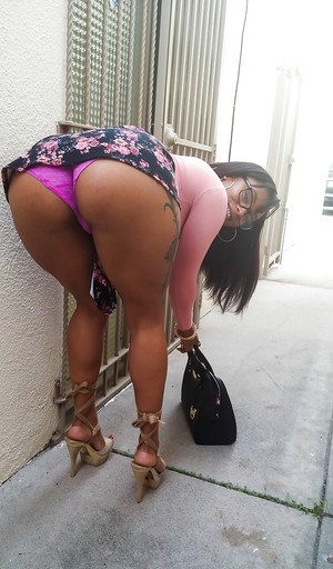 Busty black girl Porsha Carrera bends over in high heels for upskirt