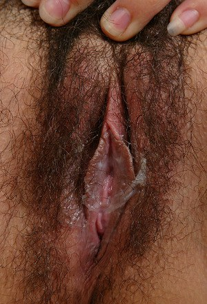 Amateur woman Lin pulls down her white panties to expose hairy bush