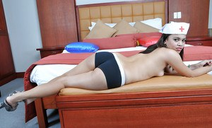 Young Latina hottie Clarice exposing small tits with nurse's hat on head