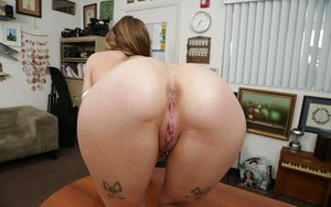 Pretty chick Sydney Cole flashes her all natural tits at work