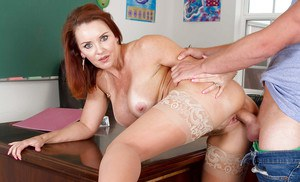 Mature redhead teacher in pantyhose Janet Mason has trimmed cunt licked out