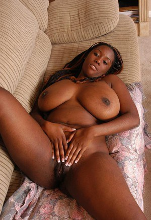 Chubby black woman Diva exposing her huge all natural black boobs