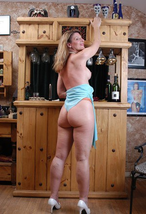 Older blonde Linda poses fully clothed before flashing firm mature tits