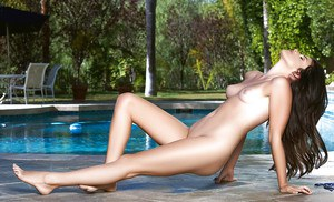 Brunette centerfold babe Belle Sinclair spreading shaved pussy outdoors