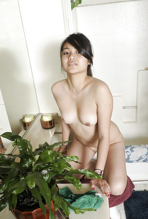 Horny Asian amateur Guilliette spreading her cheeks after a shower