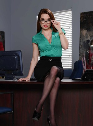 Curvy secretary Veronica Rain takes off her glasses and strips naked
