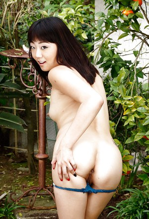 Tiny Asian exhibitionist Miko Dai spreading her pink vagina wide outdoors