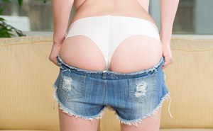 Cute teen chick Alison Rey stripping off ripped denim shorts