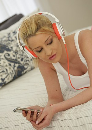 Beautiful blond teen Siena Day in bed wearing yoga pants and sports shirt