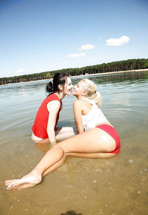 Teen lesbian Sara J introduces new friend to girl on girl sex in water
