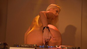 Busty blonde DJ Lynna Nisson exposing perfect large natural boobs in club