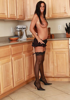 Mature babe model Susie posing in sexy stockings and lingerie in kitchen
