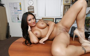 Buxom Latina office worker Natalia Mendez exposing huge hooters at work