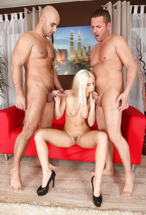 Blond babe Blanche Bradbury sucking off two cocks at once in wild FFM 3some