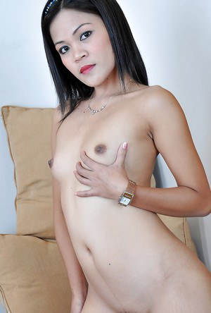 Sexy Thai girl Jhenny baring tiny breasts and erect nipples
