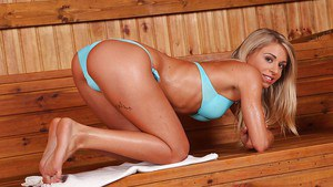 Young blonde girl Chloe Lacourt getting wet and naked in sauna