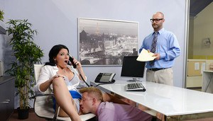 Brunette boss lady Cassy Cumz receives oral sex while on telephone