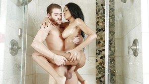 Exotic ebony chick Anya Ivy blowing huge white cock in shower