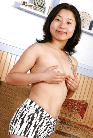 Oriental solo chick Mini masturbating her hairy Asian pussy