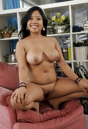 Black haired Asian Kya loves to show off her big sexy titties