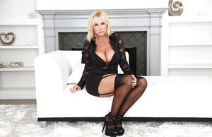 Mature blonde mom Dee Siren posing fully clothed in black stockings
